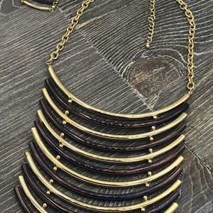 Contemporary metal statement necklace and earrings